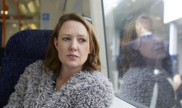 Paula-Hawkins-looking-at-the-window-559664